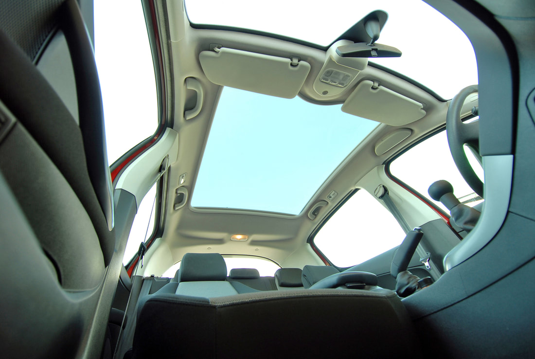 car with wide sunroof glass